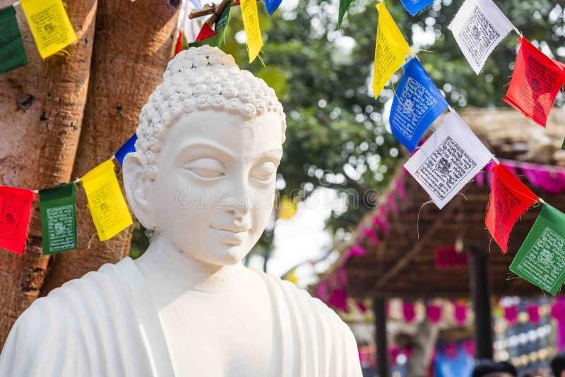 菩萨, Buddhishm的创建者阁下一个白色颜色大理石象在Surajkund节日的在法里达巴德,印度 免版税库存图片