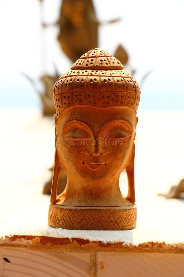 菩萨头纪念品 木头 印度 库存图片