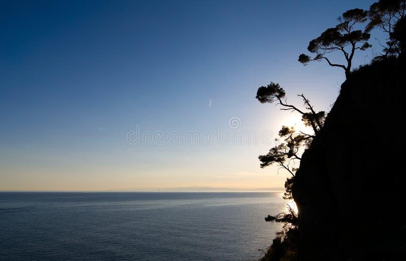 从菲诺港灯塔的日落 免版税库存照片