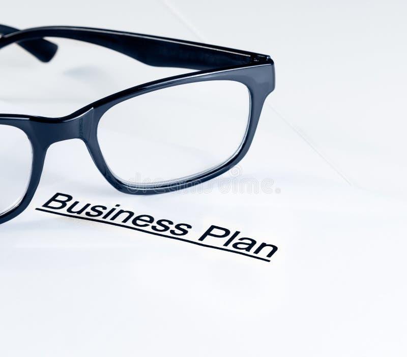 经营计划在玻璃,企业概念附近措辞 免版税库存照片