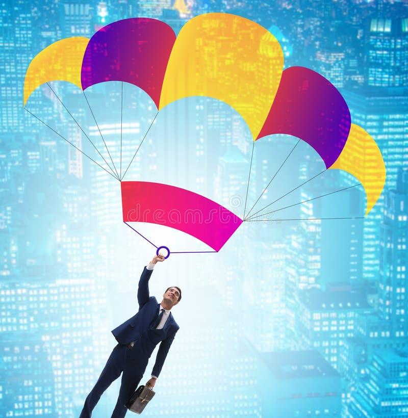 落在企业概念的降伞的年轻商人 库存图片