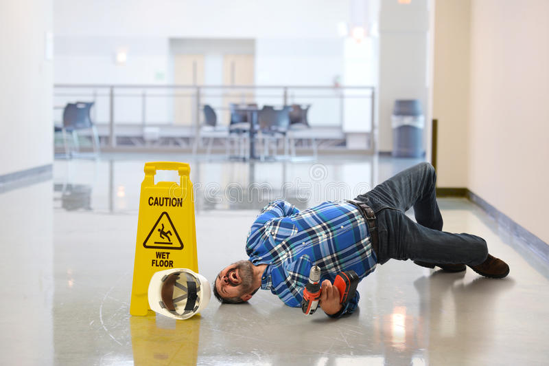 落在地板上的工作者 图库摄影