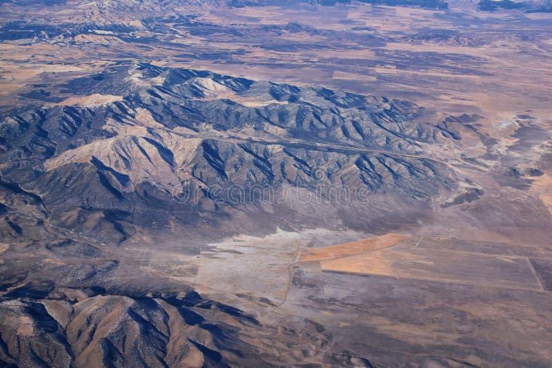 落基山脉、奥奎罗山脉从空中俯瞰,瓦萨奇前岩从飞机上望去 南约旦、西谷、麦格纳和赫里曼 免版税库存图片