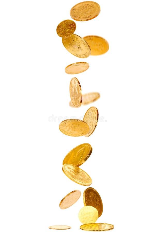 落的金币 免版税库存图片