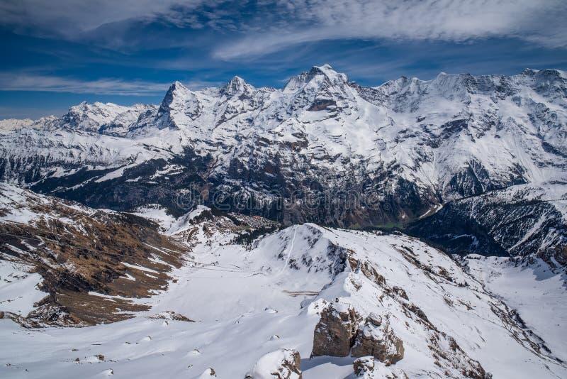 著名峰顶埃格尔、莫希峰和少女峰惊人的全景在瑞士阿尔卑斯山脉,瑞士 库存图片