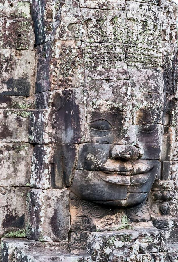 著名石微笑的面孔在Prasat Bayon,一部分的吴哥 免版税库存照片
