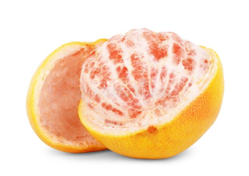 葡萄柚在与裁减路线的白色与一半的柑桔隔绝的 库存图片
