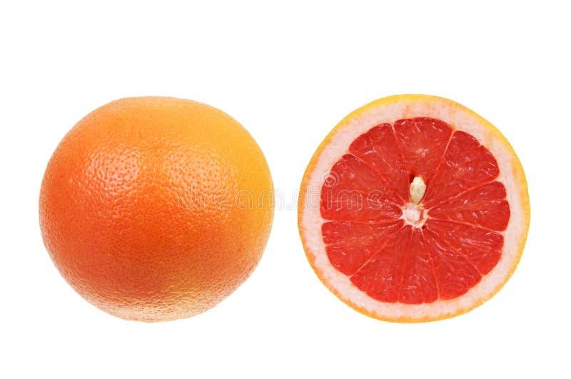 葡萄柚查出在红色白色 库存照片