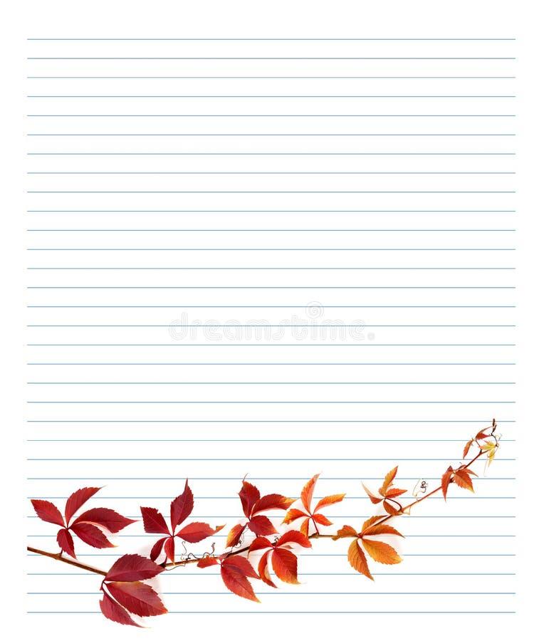 葡萄红色分支在笔记本纸离开 免版税图库摄影