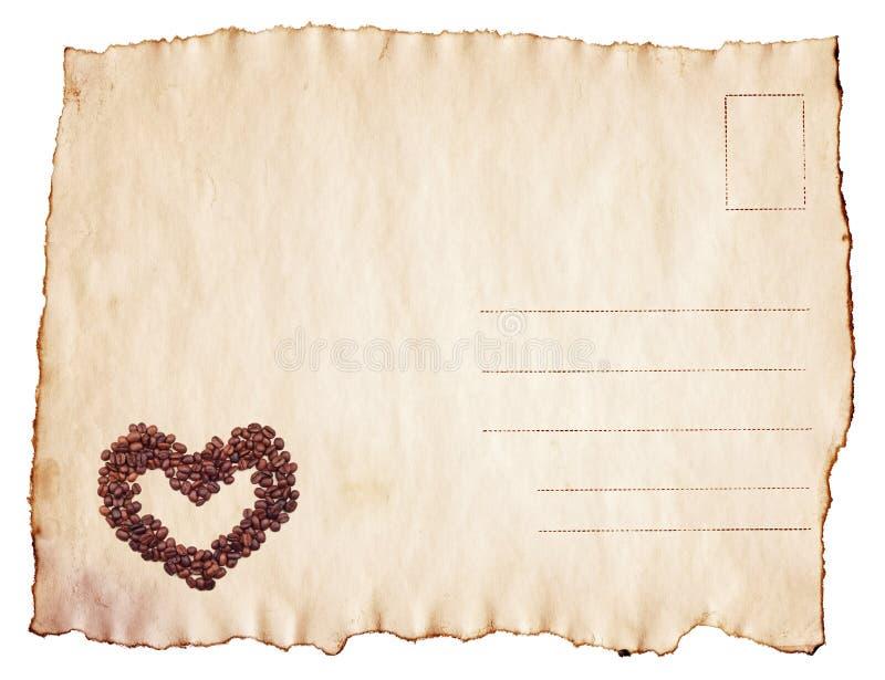 葡萄酒与咖啡豆心脏的被烧焦的明信片 库存照片