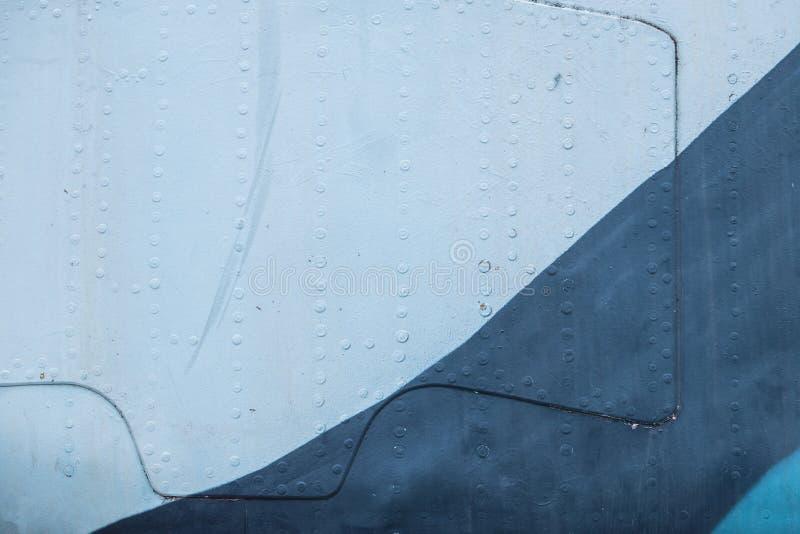 葡萄酒军用飞机金属纹理的关闭 免版税库存照片