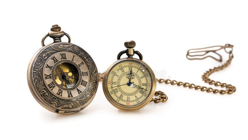 葡萄酒在白色背景的被刻记的金属手表 免版税图库摄影