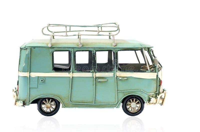 葡萄酒在白色隔绝的玩具汽车 免版税图库摄影