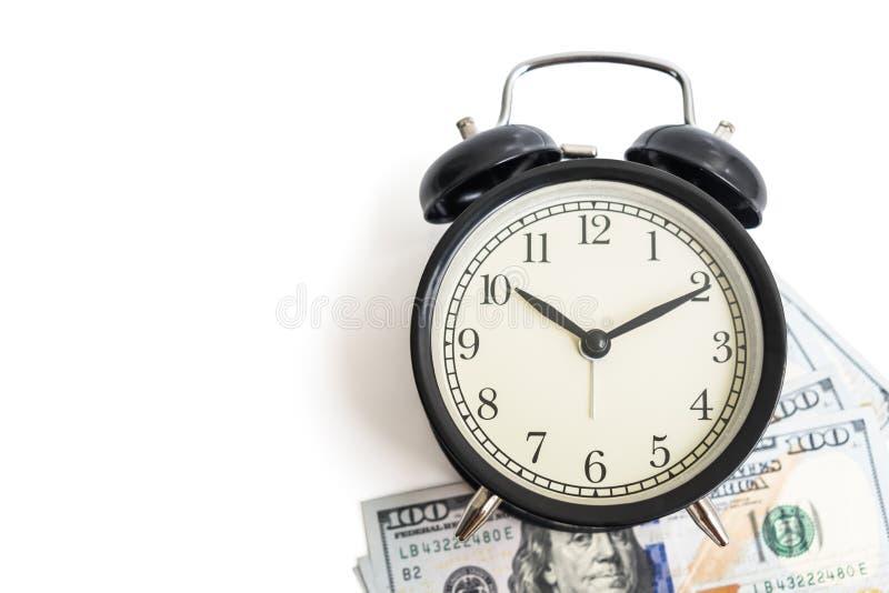 葡萄酒在美元金钱的古董闹钟被隔绝的顶视图  免版税库存图片