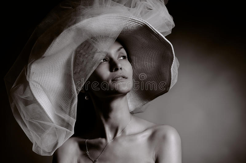 葡萄酒帽子的妇女 免版税库存图片