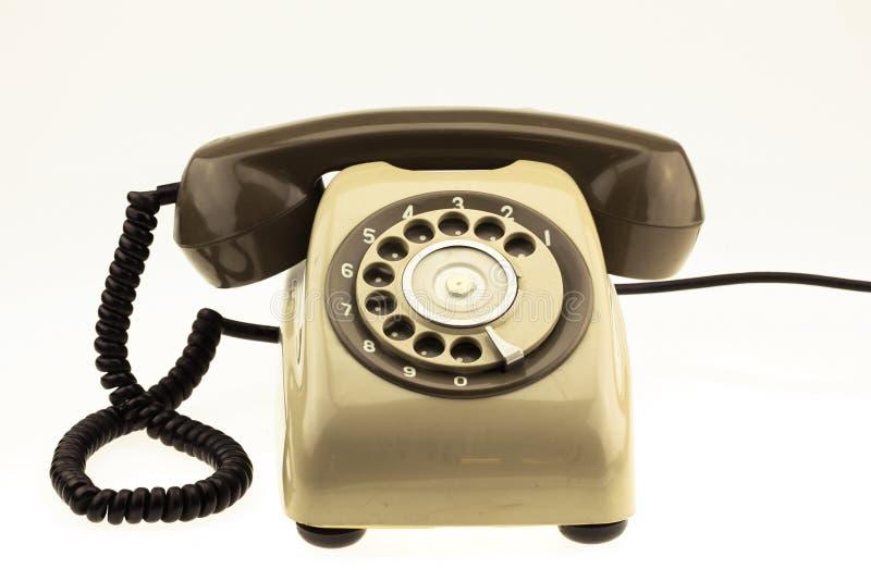 葡萄酒新的巧妙的电话图片样式有老电话的在白色背景 新的通讯技术 免版税库存图片