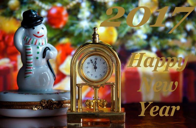 葡萄酒时钟和雪人 库存图片