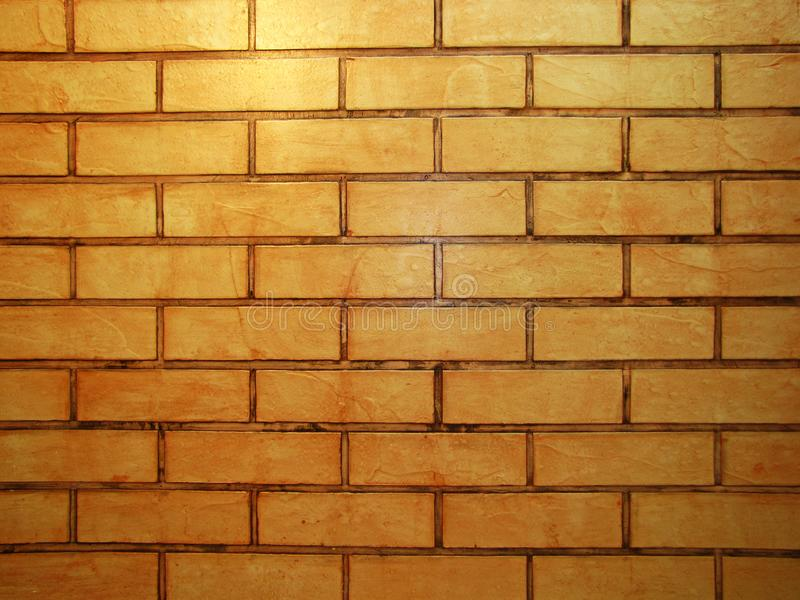 葡萄酒样式橙色口气砖墙详述了样式被构造的背景:砖砌石工细节 库存图片