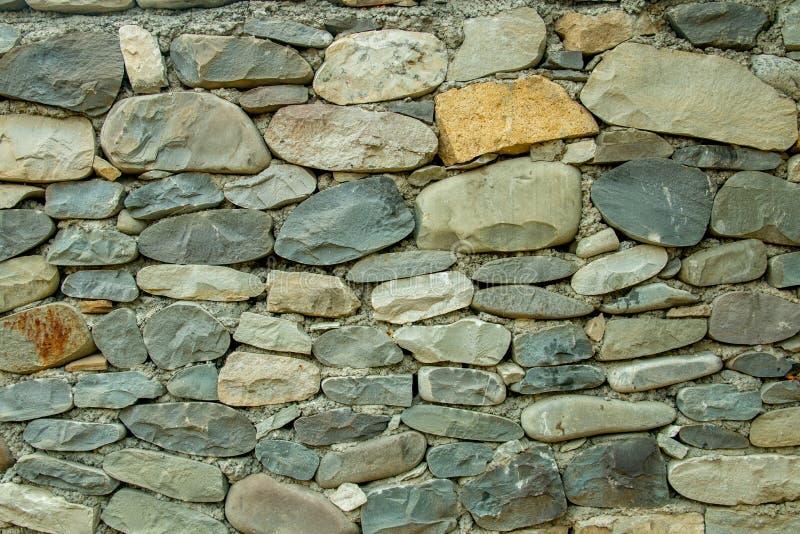葡萄酒河您的背景的石墙纹理 免版税库存图片