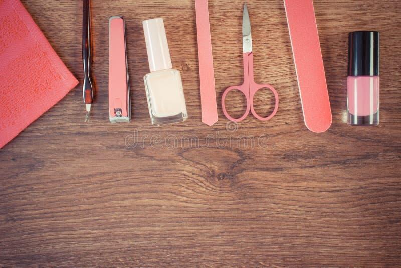 葡萄酒照片、化妆用品和辅助部件修指甲或修脚的 免版税库存照片