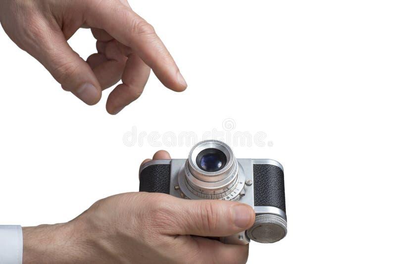 葡萄酒照相机在人的手上 免版税库存照片