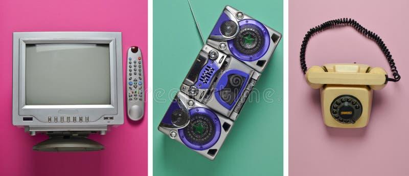 葡萄酒电视,录音磁带记录器,在淡色背景的转台式电话 免版税库存照片