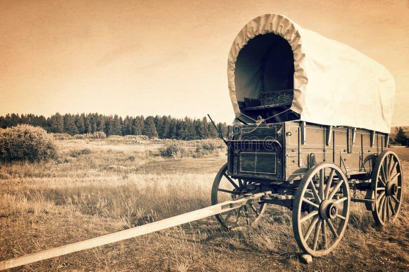 葡萄酒美国西部无盖货车,乌贼属葡萄酒过程,美国牛仔计时概念 免版税库存图片