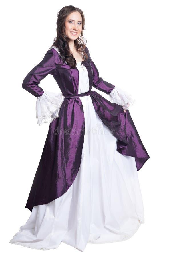 葡萄酒老礼服的年轻美丽的妇女 库存照片