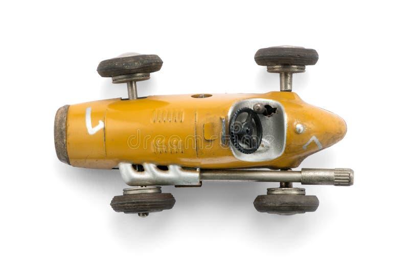 葡萄酒黄色玩具赛车 库存照片
