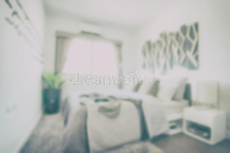 葡萄酒st的Defocus背景现代经典内部卧室 免版税图库摄影