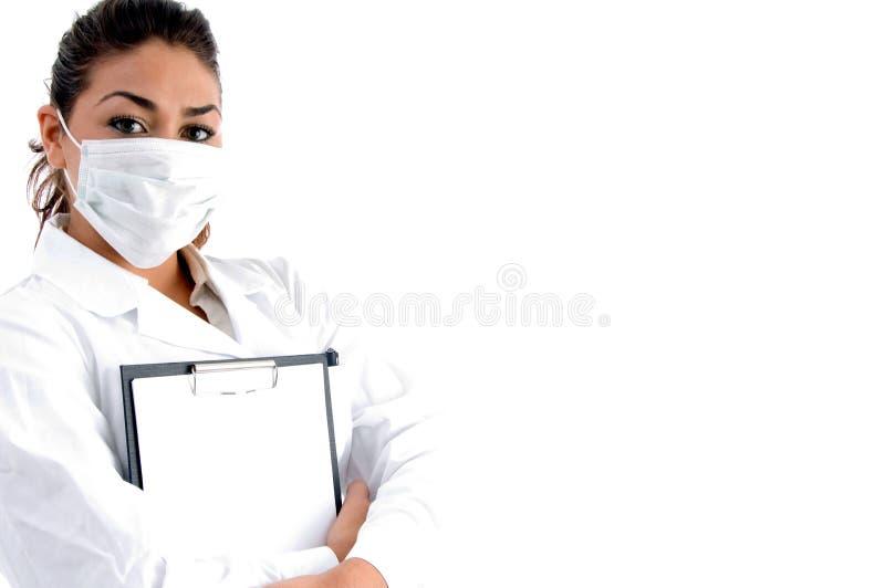 董事会医生面对她的屏蔽文字 免版税库存图片