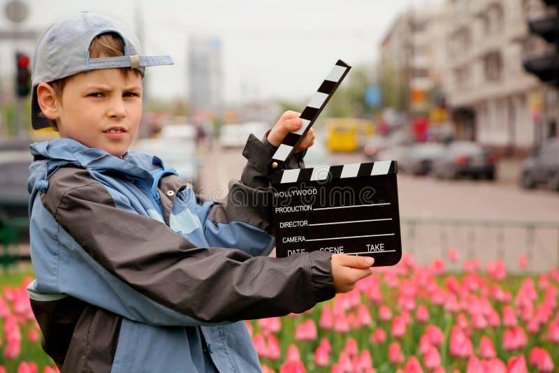 董事会男孩盖帽戏院拍板夹克 免版税库存照片