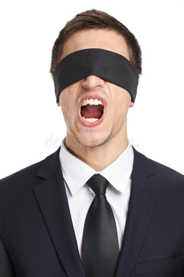 蒙住眼睛的商人尖叫 免版税库存照片