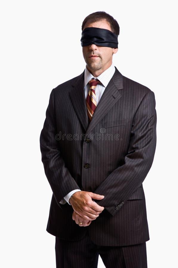蒙住眼睛的生意人 免版税图库摄影