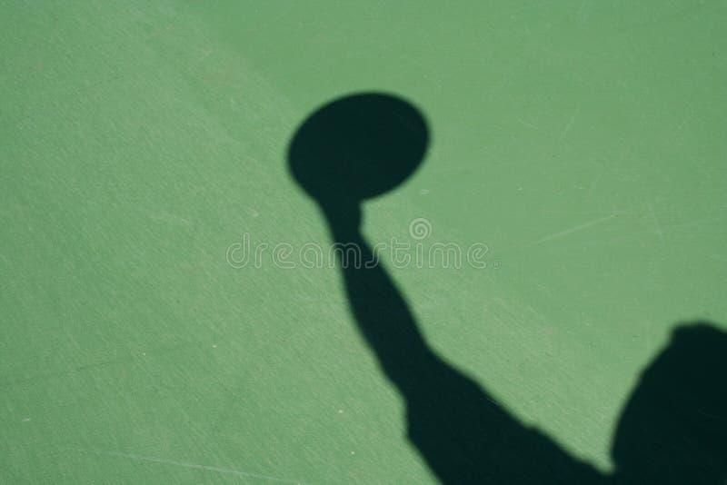 蓝球运动员影子 库存照片