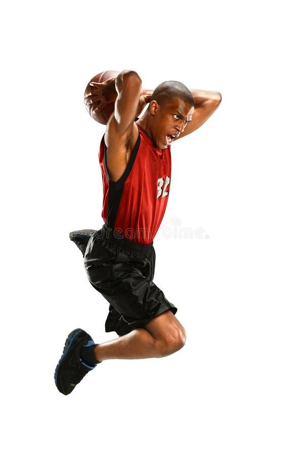 蓝球运动员跳跃 免版税库存图片