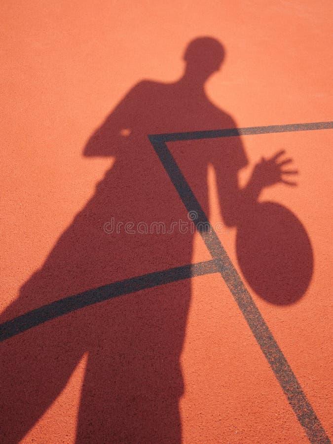 蓝球运动员阴影 库存照片