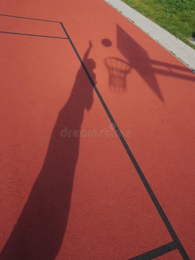蓝球运动员阴影 免版税库存图片