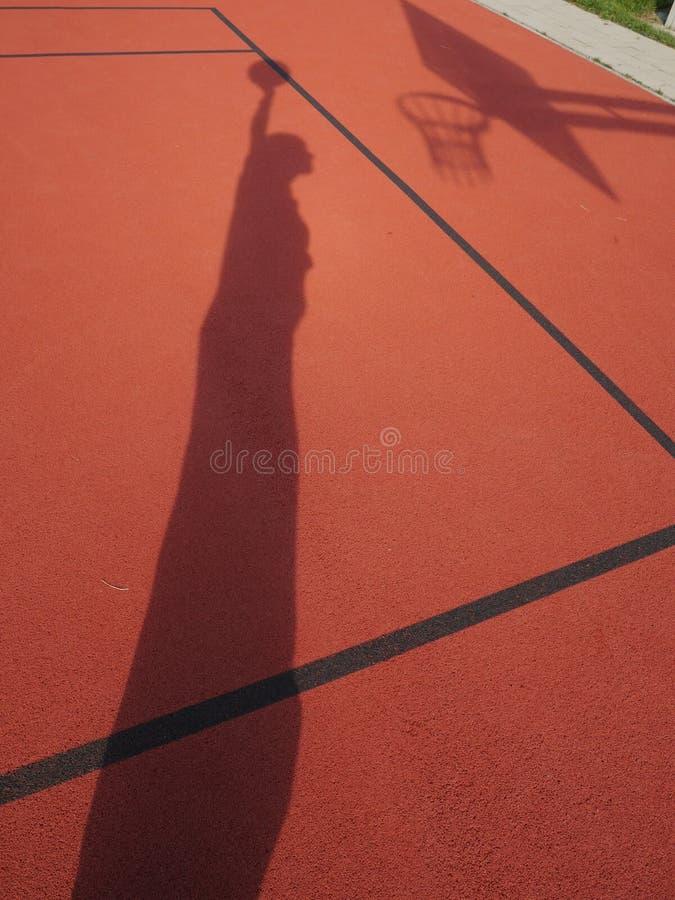 蓝球运动员阴影 免版税库存照片
