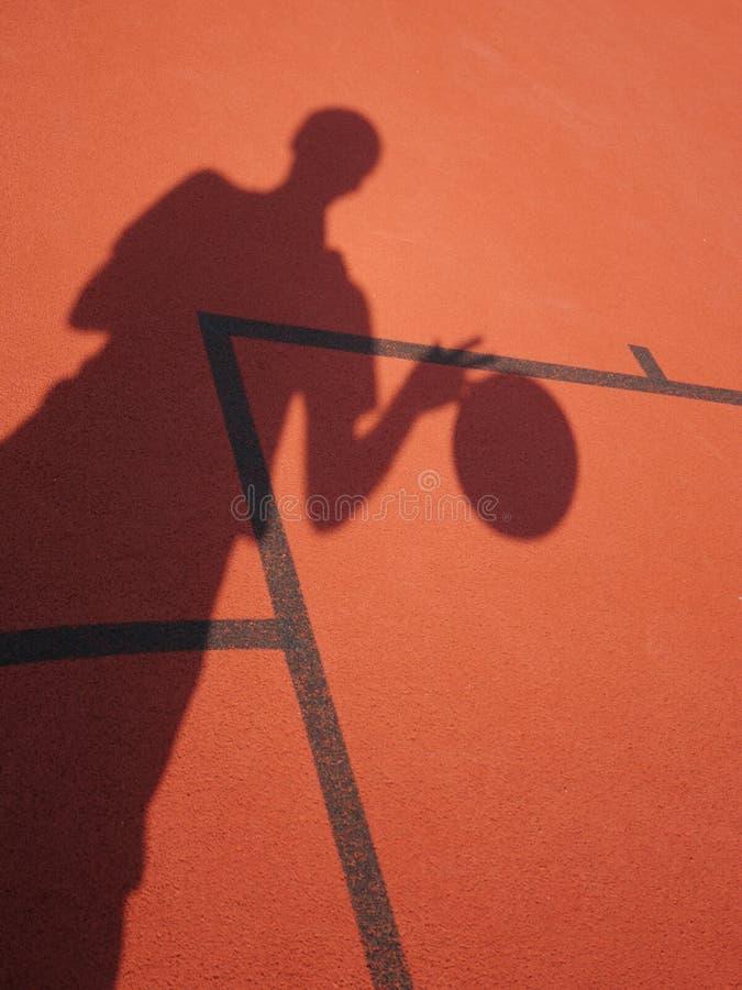 蓝球运动员阴影 图库摄影