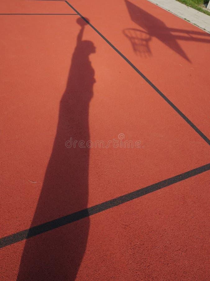 蓝球运动员阴影 免版税图库摄影