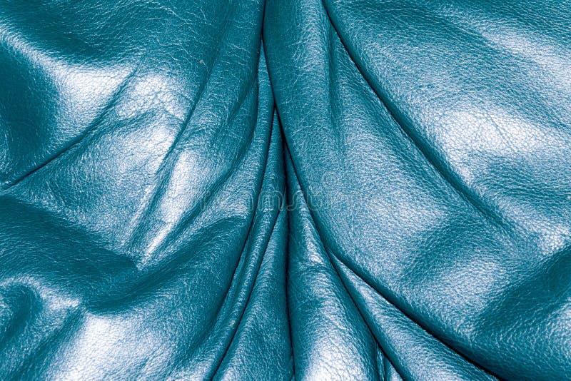蓝绿色皮革纹理特写镜头,有用作为背景 免版税图库摄影