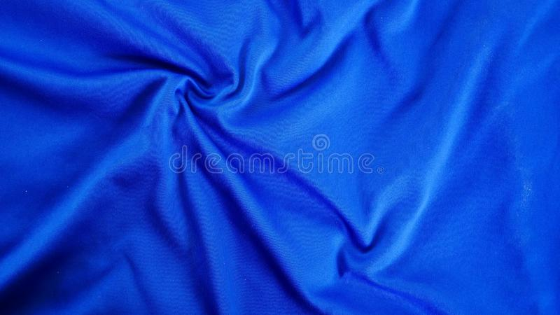 蓝色丝绸缎纹理,棉织物背景 免版税库存照片