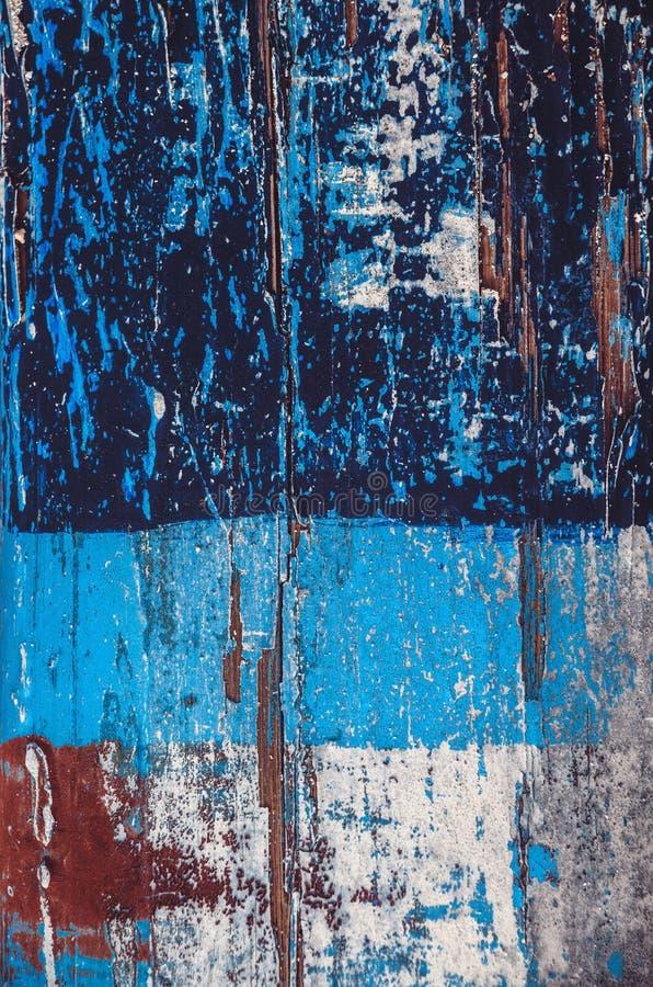 蓝色五颜六色的被抓的木纹理 库存图片