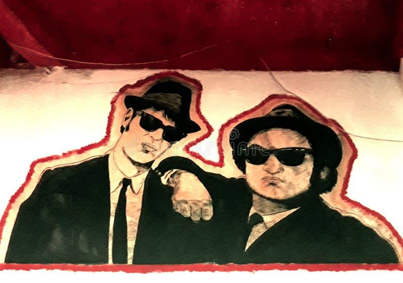蓝色兄弟murales在客栈 库存照片