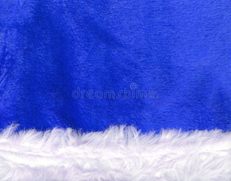 蓝色克劳斯接近的帽子圣诞老人纹理 免版税库存图片