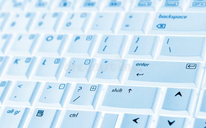 蓝色关键董事会膝上型计算机 免版税库存图片