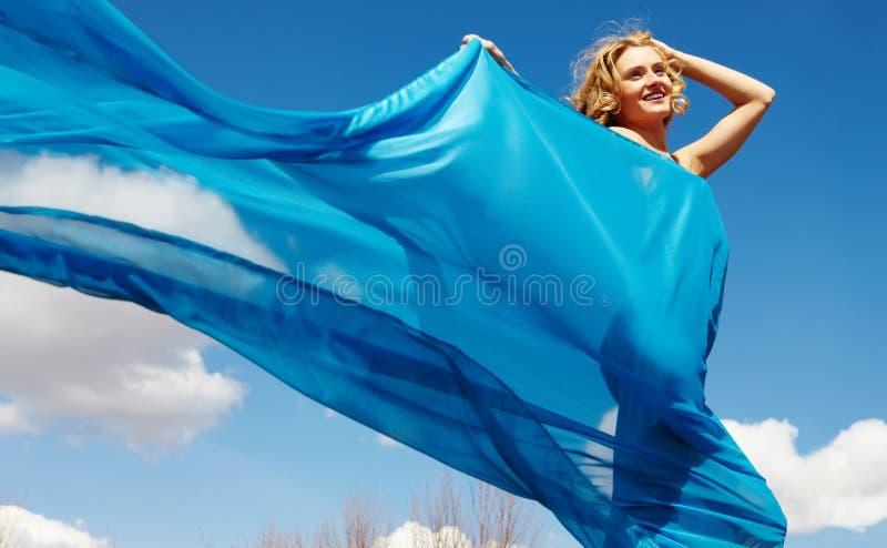 蓝色华美的妇女 免版税库存照片