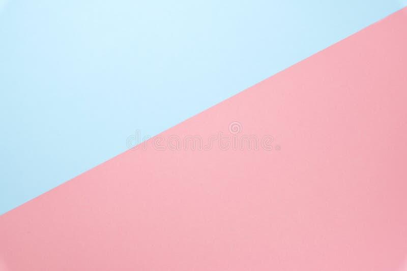 蓝色和桃红色淡色纸的颜色背景的 最小的概念纹理 r 免版税库存图片