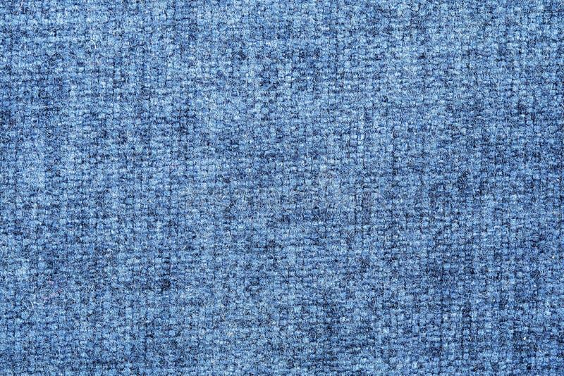 蓝色和淡色织品纹理  免版税库存图片